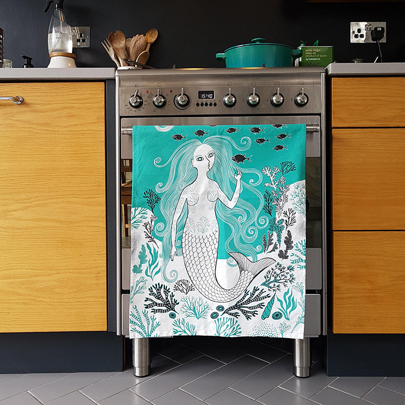 Mermaid tea towel hanging on the cooker