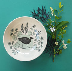 Lush Designs Moorhen printed bowl shown with a small posy of spring flowers