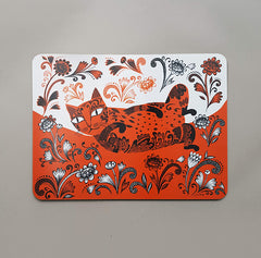 table mat depicting orange cat with fancy patterns  rolling in flowers