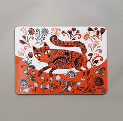 Table mat with orange black and white print of kitten walking
