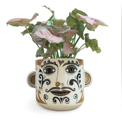 Lush designs plant pot printed with patterned clown face and featuring 3D ears on ether side