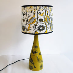 Lush Designs ceramic lamp base in yellow-green with matching shade all printed with partridges and other small birds