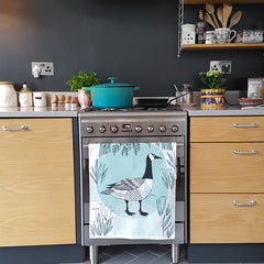 Lush Designs Canada Goose print tea towel hanging up in the kitchen