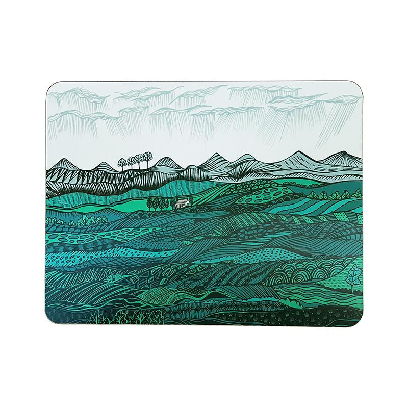 Lush Designs table mat depicting rolling green hills and a distant cottage