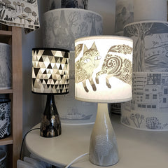 Lush Designs lamps, with shades printed with triangle pattern and kitten print
