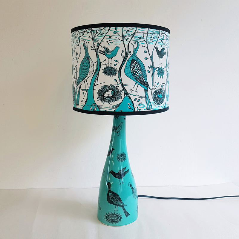 Lush Designs ceramic lamp base in blue-green with matching shade all printed with partridges and other small birds