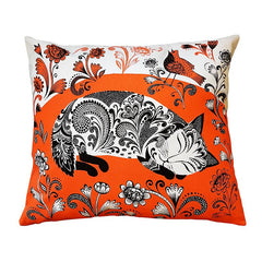 cushion printed with sleeping black and white kitten on orange floral background