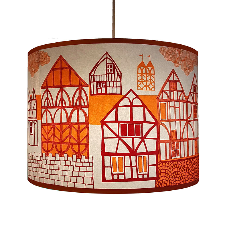 Lush Designs lampshade printed with tudor houses in shades of orange