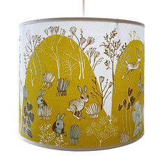Lush Designs lamshade printed with countryside scene with rabbits in brilliant yellowy green