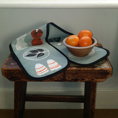 Salt and pepper design oven gloves pictured with bowl of satsumas