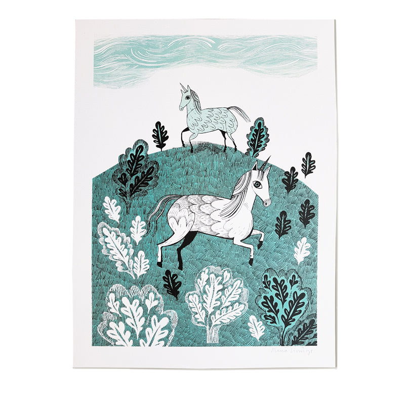 Lush Designs print on art-paper of two unicorns on a hillside with trees in Turquoise and black