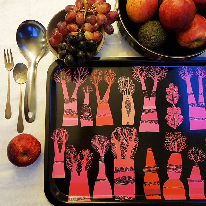 Lush Designs black oink and orange tray with abstract tree print shown with bowls of fruit and arty cutlery