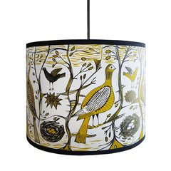 Lush Designs lampshade printed with partridges and songbirds in a woodland setting in mustard and black