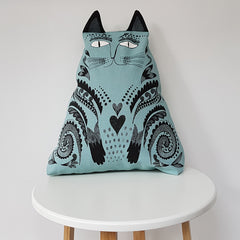 Lush Designs cat-shaped cushion on a white modern stool