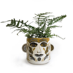 Lush designs plant pot printed with patterned clown face in olive and black on cream and featuring 3D ears on either side