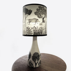 Lush designs ceramic lamp base with lampshade printed with wild boars and little trees in very dark brown