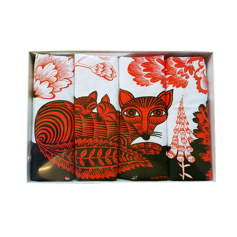Four Lush Designs Fox and Cubs print napkins in a box