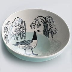 Stoneware salad bowl with printed interior illustration of a canada goose in peppermint green and black