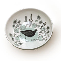 Lush Designs stoneware pasta bowl with printed image of a moorhen and flowers on the inside in black and pale green