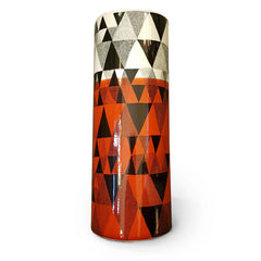 Geometric design of triangles printed vase in orange, black and white
