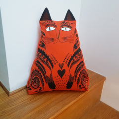 Lush Designs cat-shaped cushion in orange and black