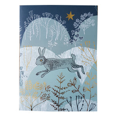 Lush Designs christmas card in shades of blue with rabbits and gold foil decoration