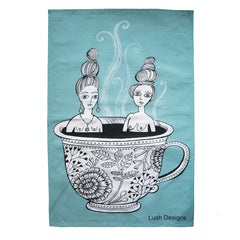 Lush Designs blue cotton tea towel with print of naked ladies sharing a bath in a tea cup