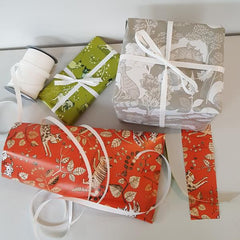 Lush Designs wrapping paper parcels with ribbon bows