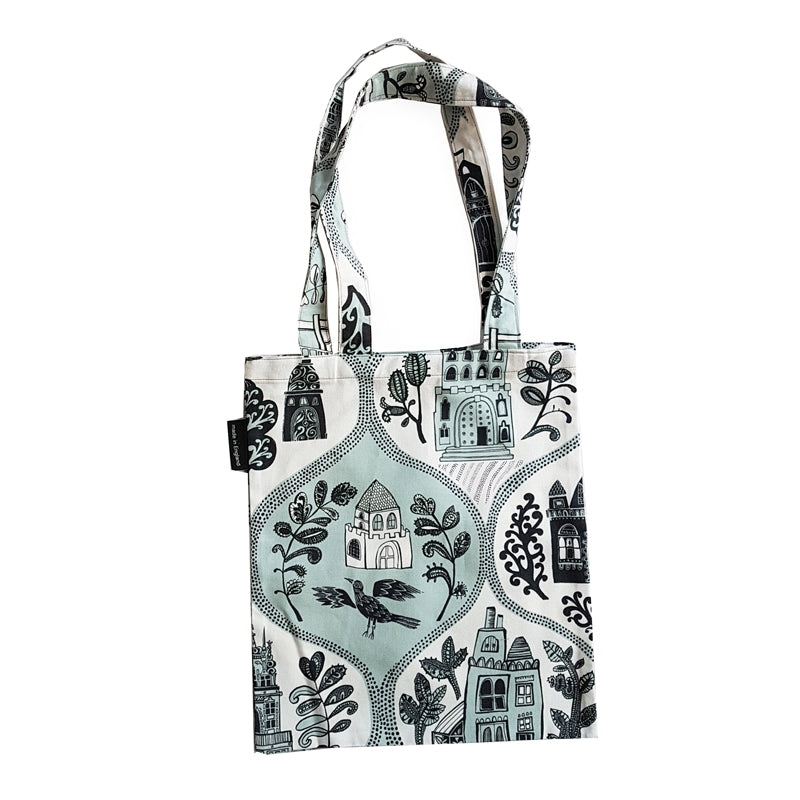 Lush Designs mini tote-bag with teal and black print of little houses, trees and animals