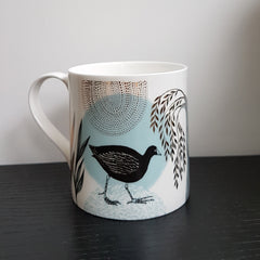 Lush Designs bone china mug with moorhen print in black and light blue and gold embellishment