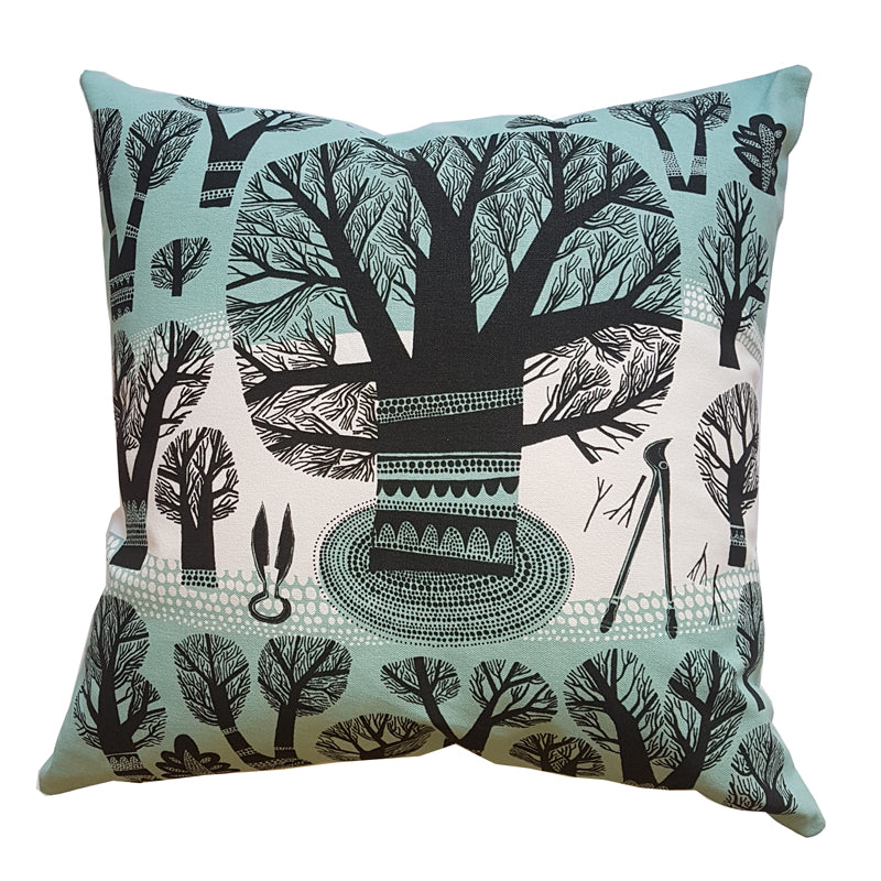 Lush designs cushion with print of winter trees and garden tools in black and teal on white