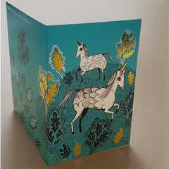 Lush Designs unicorn print card with graphic drawing of cute unicorns and gold foil features