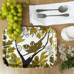 Lush designs loris-print tray in a lifestyle setting with green grapes, flowers and cutlery