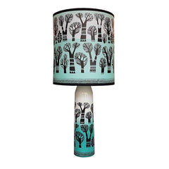 Lush Designs lamp in teal, black and white featuring tree print on shade and base
