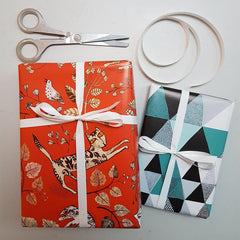Cat and triangle print gift wrapped parcels in orange and turquoise