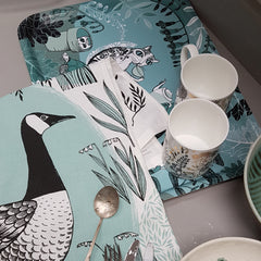 cat print tray with cups on it and goose print tea towel and spoon