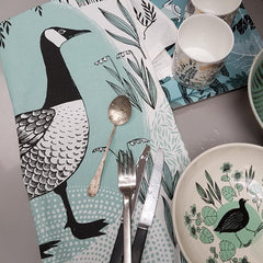 Lush Designs tea towel with goose print, cutlery and bowl with moorhen print