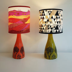Two lush designs ceramic lamp bases with colourful patterned lampshades