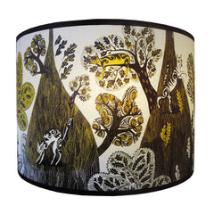 Mustard, yellow and dark brown print of naughty cats in the trees and flowers on a Lush Designs lampshade