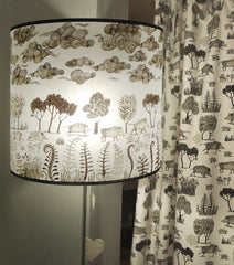 Lush Designs wild boar print shade in large size on a standard lamp shown with wild boar print fabric curtain