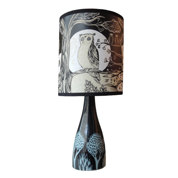 Lush Designs ceramic lamp base with white printed plant design shown with black, white and cream owl print lamp shade