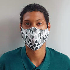 triangle patterned black and white mask work by a teenage boy