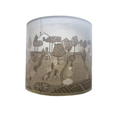 neutral coloured lampshade with print of houses and gardens