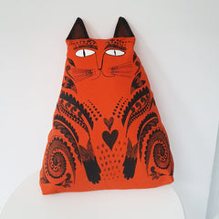 Lush Designs cat-shaped cushion in rich orange