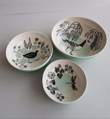 Three pond-themed illustrated bowls featuring water-birds, plants and dragonfly.