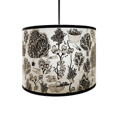 Lush Designs lampshade with detailed print of plants and gardening implements