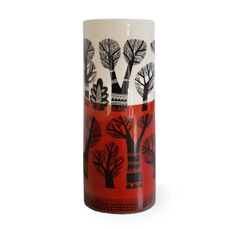 Cylindrical earthenware vase with landscape of winter trees, dipped red glaze