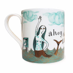Lush Designs bone china mug with print of tattooed mermaid in turquoise and black decorated with gold lustre