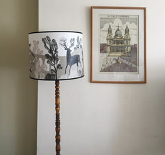 Lush Designs Stag print shade in taupe and black pictured in customers home on turned wood lamp