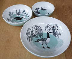three ceramic bowls with water-fowl themed prints